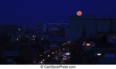 Moon set on dawn in town - Early morning town under moon...
