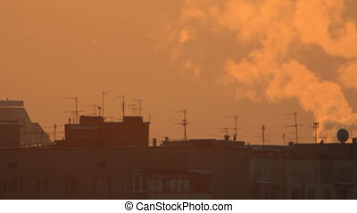 Apartment house roof in smokes - Town apartment house roof...