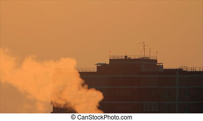 Apartment silhouette behind smog - Town apartment silhouette...