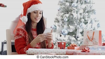 Attractive woman checking for Christmas messages -...