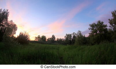 Sunset over the meadow Krasny Yar, Lubinsky District, Omsk...