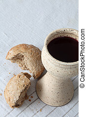 Bread and wine - Chalice with red wine and bread in...
