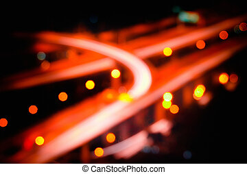 Blurred futuristic night view of highway interchange....