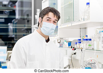 surgical mask - man working in laboratory wearing a surgical...