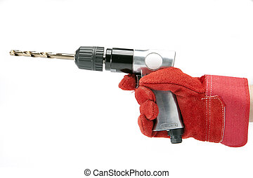 hand in a working glove holds reversible air drill