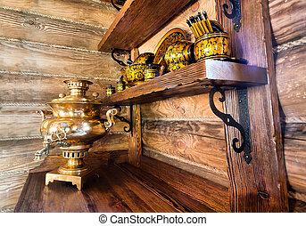 Traditional russian samovar with cups on kitchen