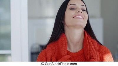 Smiling gorgeous young brunette woman in winter fashion...
