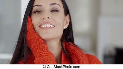 Pretty young woman with a gorgeous smile resting her head on...