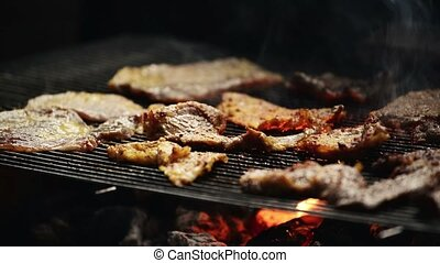 Pork meat chops on barbecue, natural light, retro toned,...