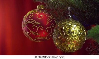 Christmas balls over bright red background - Close up...