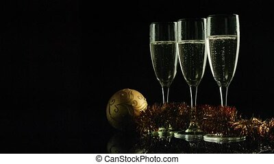 Glasses of champaigne against black background - Glass of...
