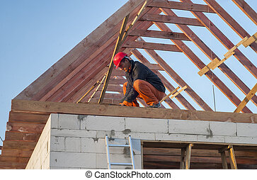 roof truss system - Builder trying to board attic floor...