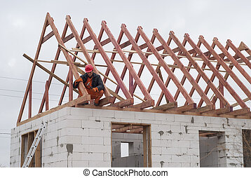 installation of roof system - builder is installing roof...