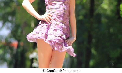 Young girl body poses - Young girl in violet dress posing in...
