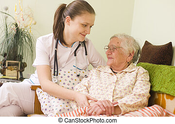 Helping a sick elderly woman - A young doctor / nurse...