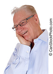 Laughing older man - A happy older man with one hand on his...