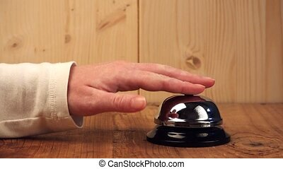 Nervous woman at hotel reception - Nervous woman ringing...
