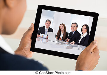 Businesswoman Video Conferencing On Digital Tablet -...
