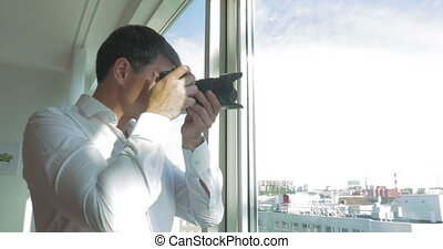 Man taking pictures of city view