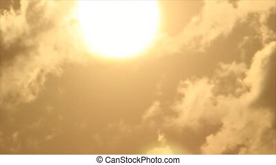 Sun disk in clouds - Bright sun disk through clouds on sky