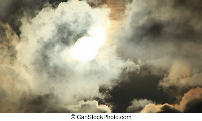Sun hides from dark big clouds