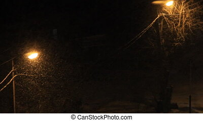 Night snowfall covers electric line - Snow view in lantern...
