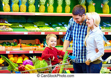 happy family buying healthy food in supermarket