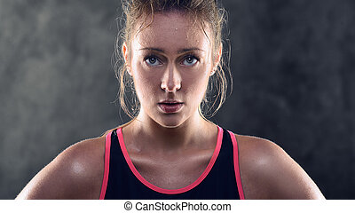 Sweating Athletic Blond Woman Wearing Tank Top - Head and...