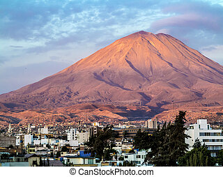 Arequipa, Peru with its iconic volcano Chachani in the...