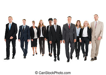 Confident Business Team Walking Against White Background -...