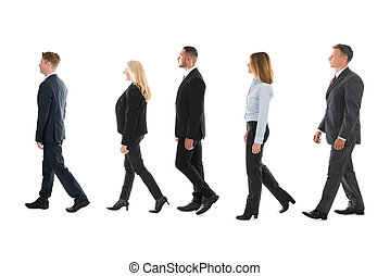 Business People Walking Against White Background - Full...