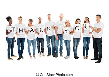 Confident Volunteers Showing Thank You Sign - Full length...