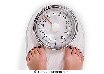 Womans Legs On Weighing Scale Over White Background - High...