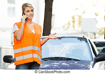 Woman Using Mobile Phone With Broken Down Car On Street -...