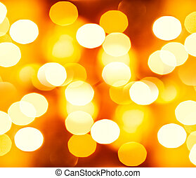 Golden festive background, beautiful blurry glowing yellow...