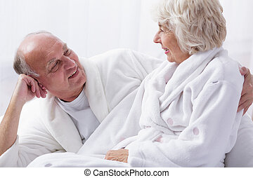 Elderly couple in bed - Photo of happy elderly couple in bed