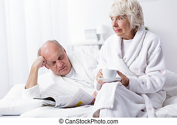 Mature marriage resting in bed - Photo of mature marriage...
