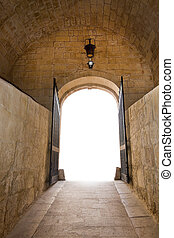 Mdina - Vaulted old medieval stone hall with iron gate...