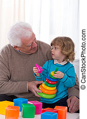 Taking care of grandson - Cheerful grandfather taking care...