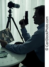 Hitman with gun - Image of hitman with gun and victim photo