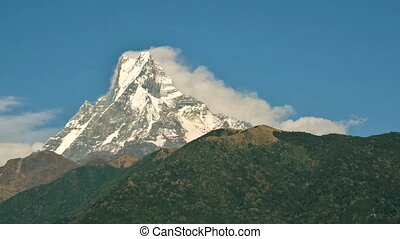 Machapuchare cinemagraph, Nepal - Clouds running down the...