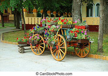 Decorative cart with flowerpots - old wooden cart with...