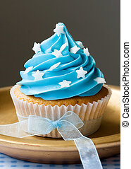 Blue cupcake - Single blue cupcake decorated with stars and...