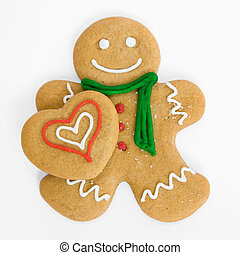 Gingerbread man with gingerbread heart - Smiling gingerbread...