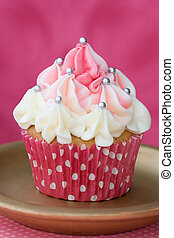 Pink and white cupcake decorated with silver dragees