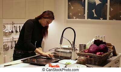 A woman washes the baking tray sponge with SOAP - Girl...