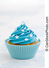 Blue cupcake - Cupcake decorated with blue frosting and...