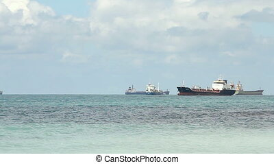Oil tanker sailing in the sea at sunny day