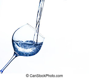 water is poured into a water glass - pure and clean water is...