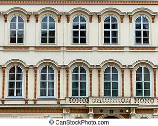 mullioned windows in an elegant old building beautiful,...